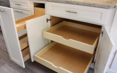 photo of custom kitchen cabinets with roll out shelves and a pull out spice rack