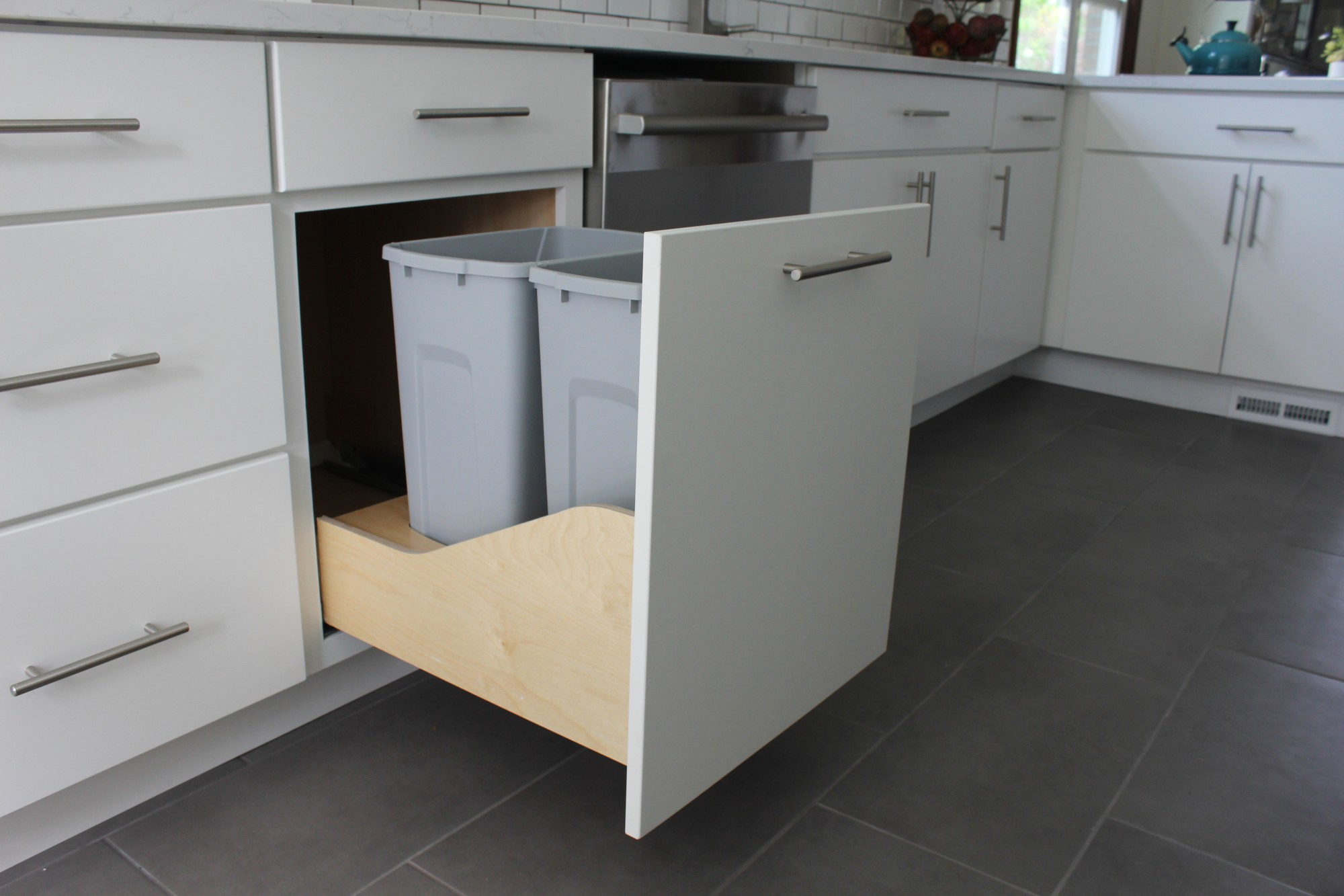 photo of pull out trash can cabinet