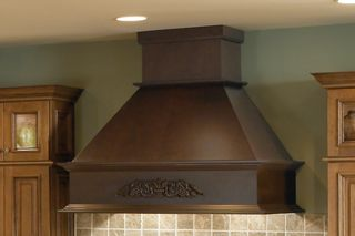 photo of a built in range hood made using custom cabinets