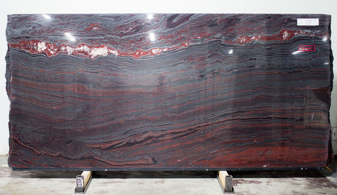 photo showing a slab of iron red granite ready before being fabricated into granite countertops
