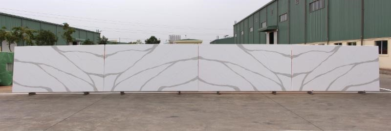 Photo of 4 book matching quartz countertop slabs