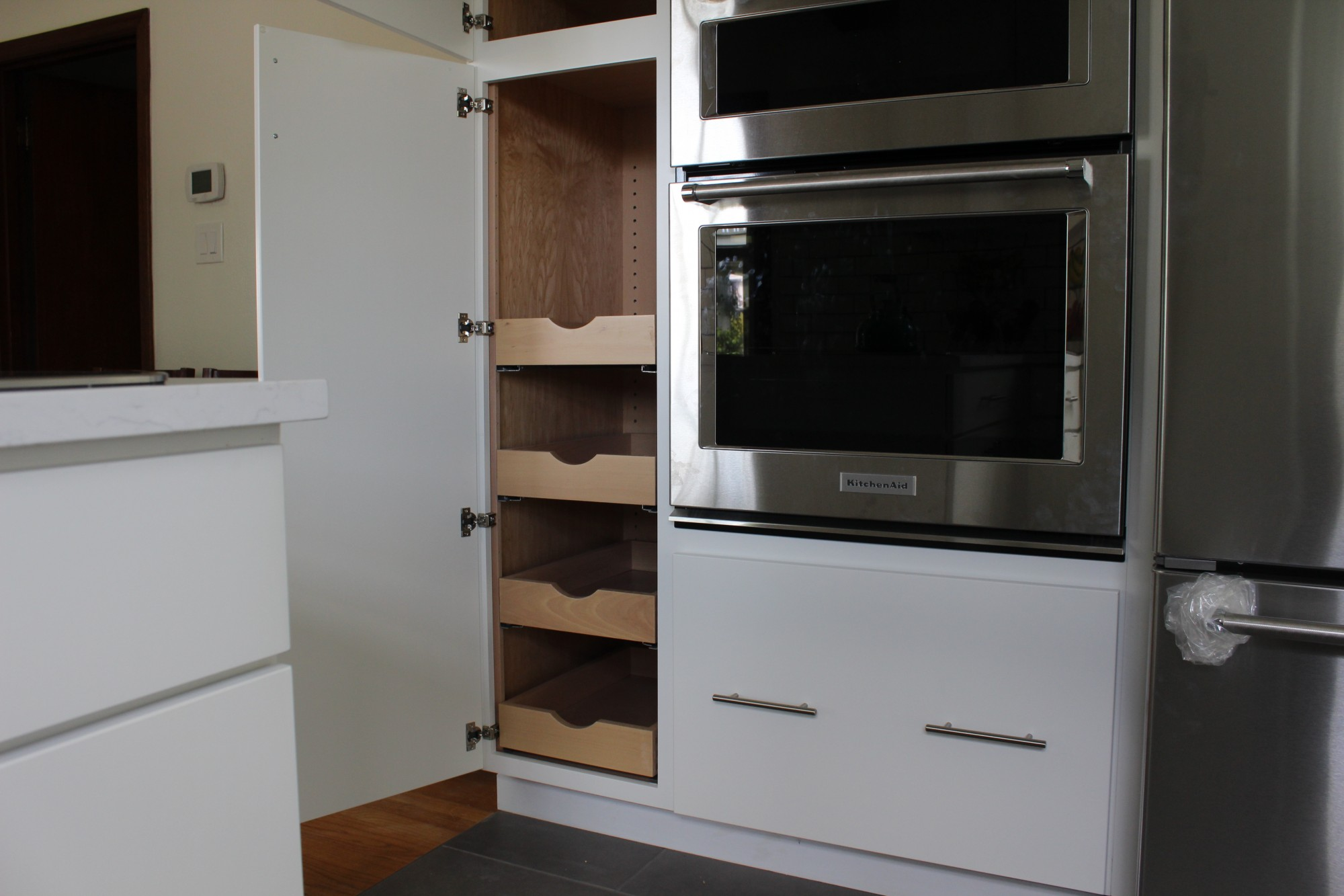 photo of roll out shelving in pantry cabinet