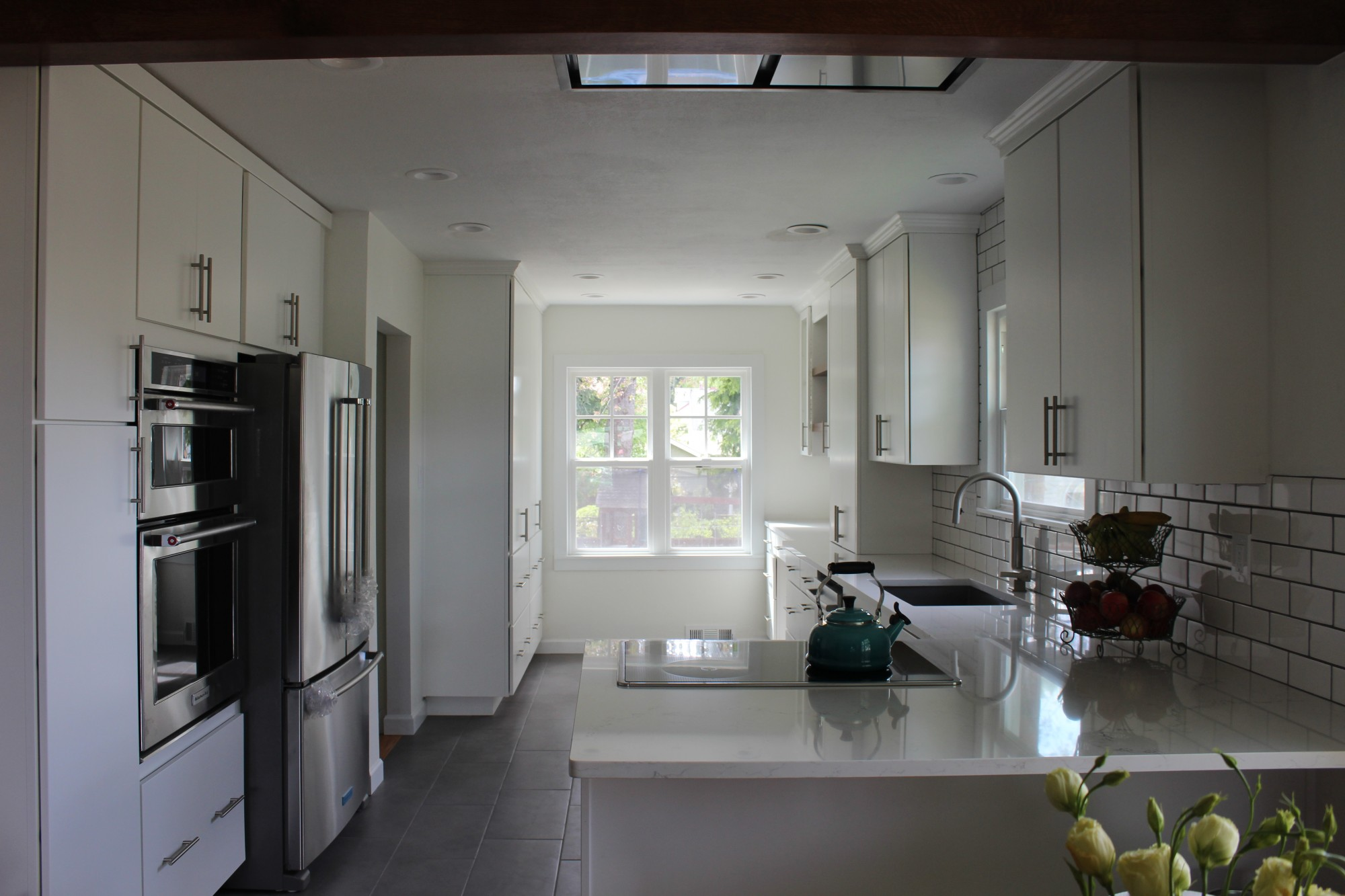 Photo Of White Kitchen Cabinets With White Quartz Countertops