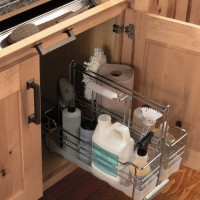 Organize cleaning items under the sink with a pull out caddy.