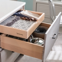 Maximize space inside drawers with tiered hidden storage.
